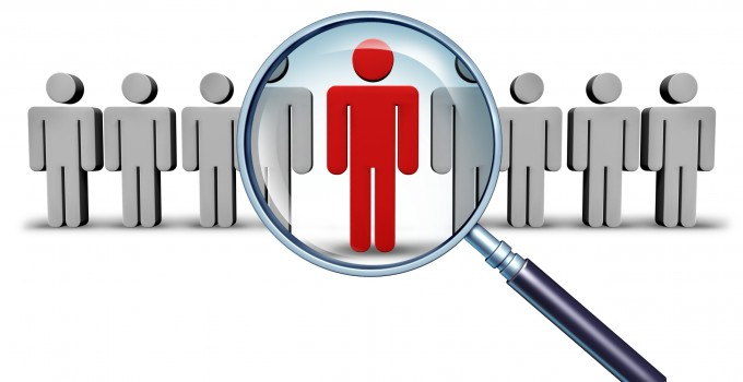Job search and career choice employment concept with human icons and a red businessman character in a magnifying glass as a symbol of recruitment and occupation